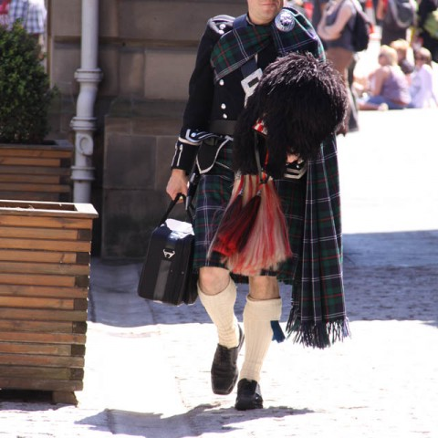 Alex the Piper walking to the City Chambers in Edinburgh