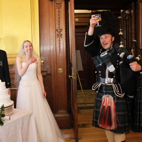 Bagpiper in Edinburgh toasting the newly weds