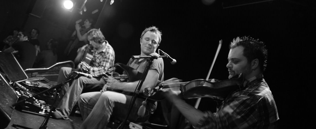 Black and white image of a ceilidh band in Edinburgh